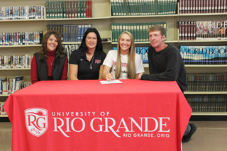 Pleasant High's Kayla Briley is joined by her parents and Rio head coach Billina Donaldson as she signs with the RedStorm